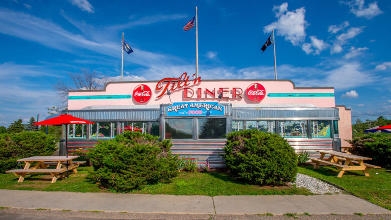 tilt'n diner exterior entrance path and picnic tables