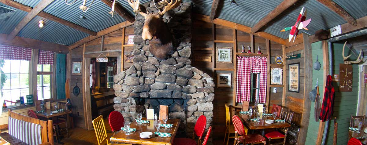 moose head over fireplace in camp dining room