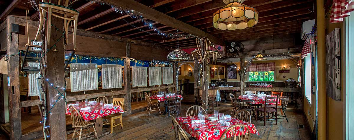 tables set up and around rustic italian farmhouse dining room