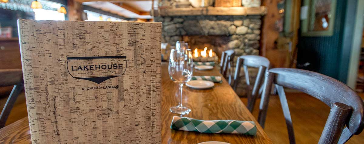 lakehouse menu on table with stone fireplace in background