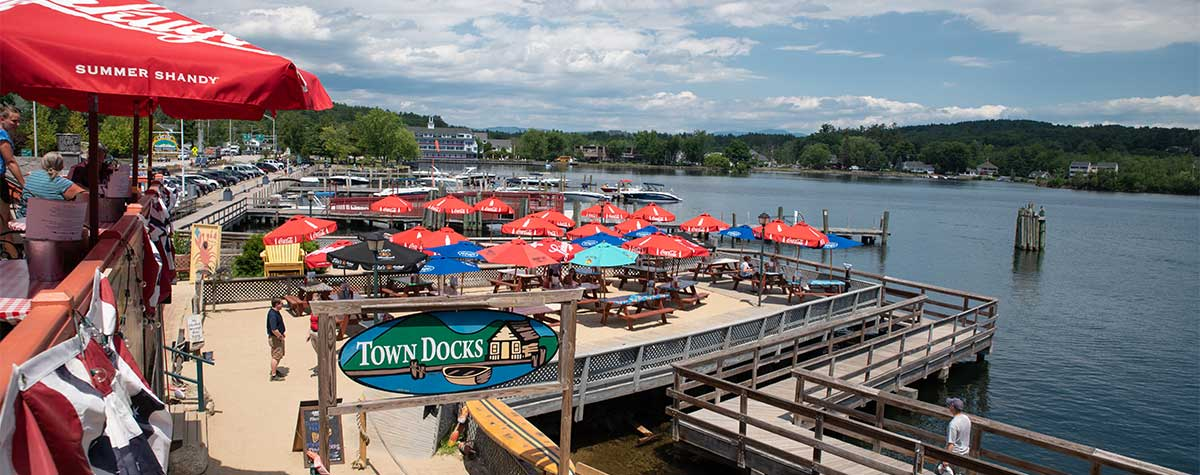 picnic tables outside at the dock overlooking lake at town docks restaurant