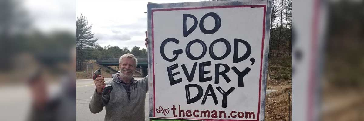 alex, owner of the common man, putting up a do good every day road sign