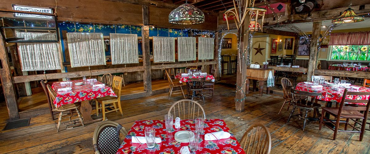 italian farmhouse dining room with tables in rustic barn style setting different angle