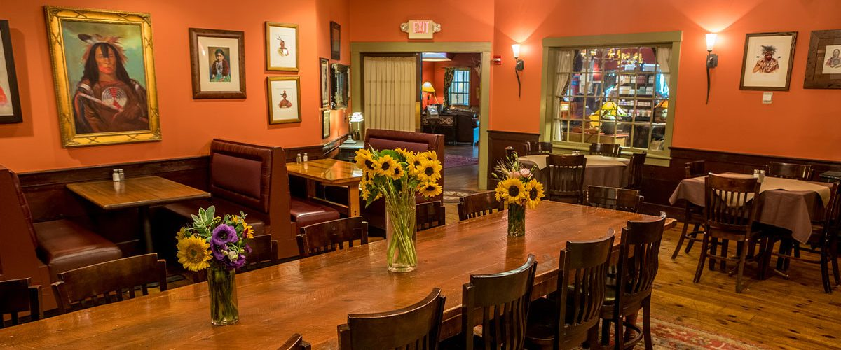 common man inn and spa dining room with sunflowers on tables in vases