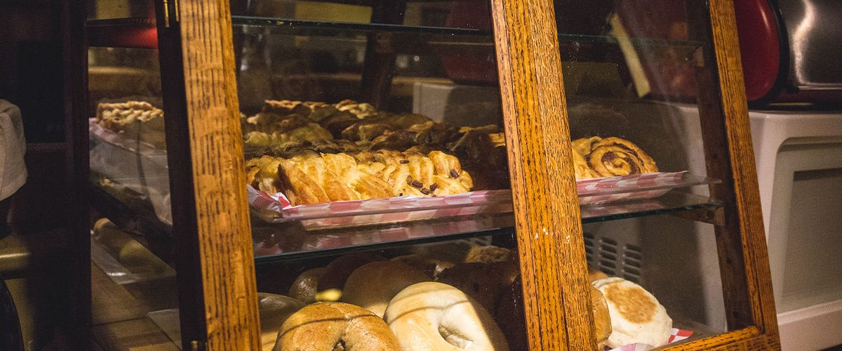 continental breakfast offerings of bagels and pastries in pastry cabinet