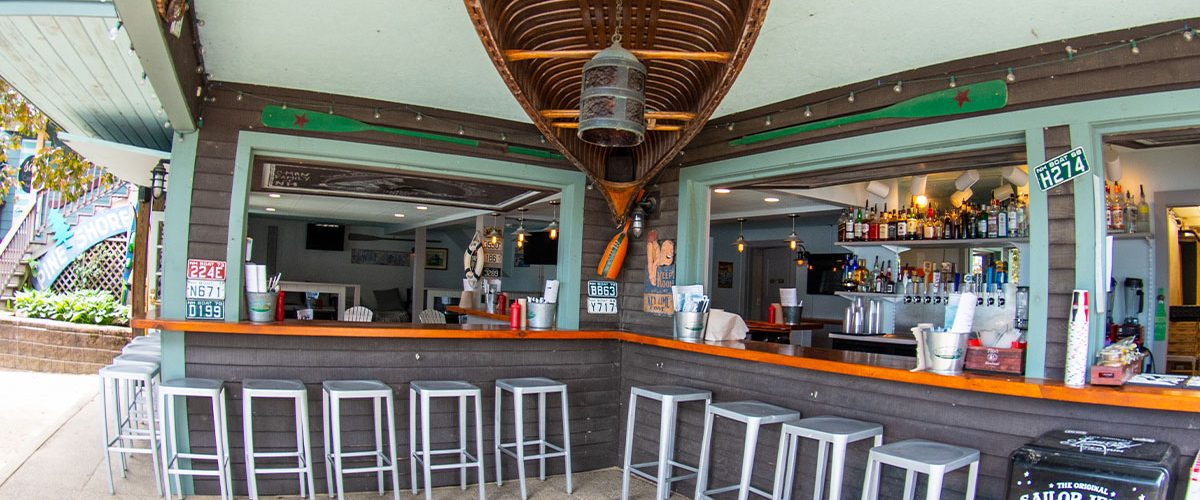 south docks outdoor bar with canoe hanging from ceiling